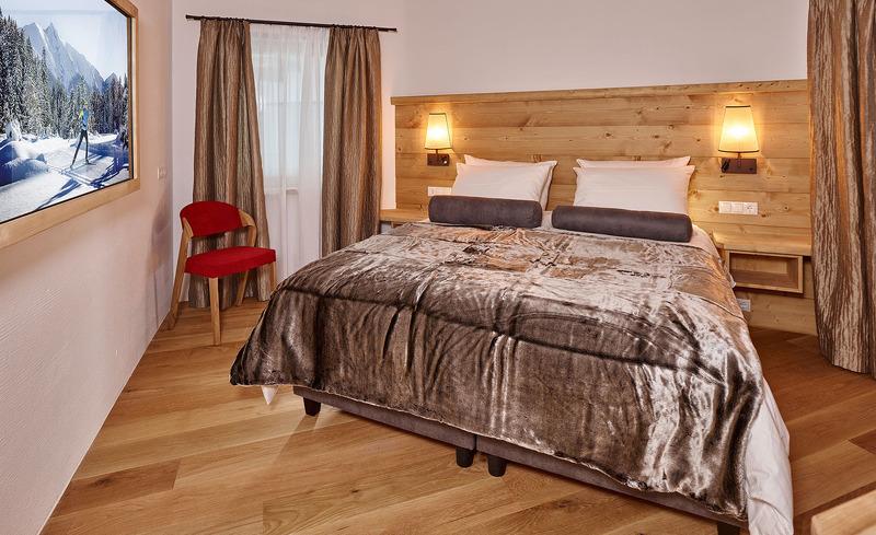 Die komfortablen Betten der Löwen Chalets laden zum Entspannen ein