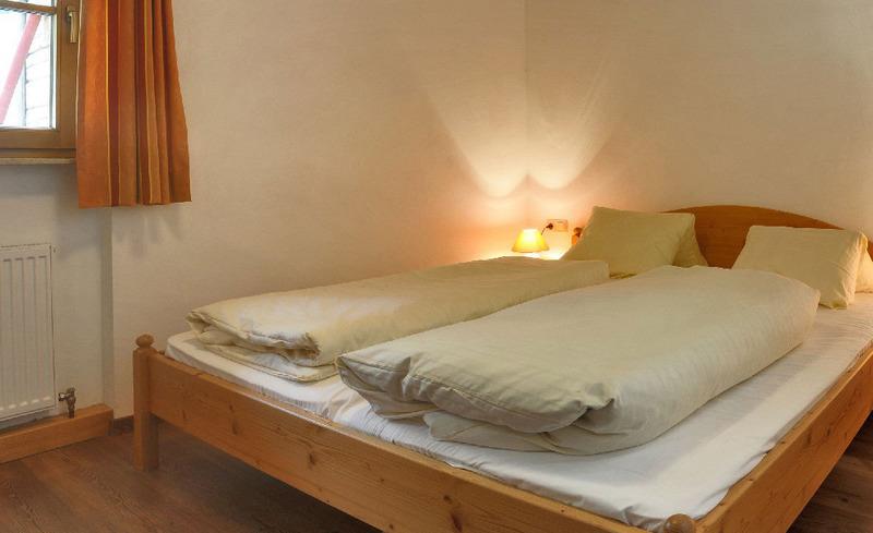 Komfortable Schlafzimmer in den Ast'n Hütten im Salzburger Land