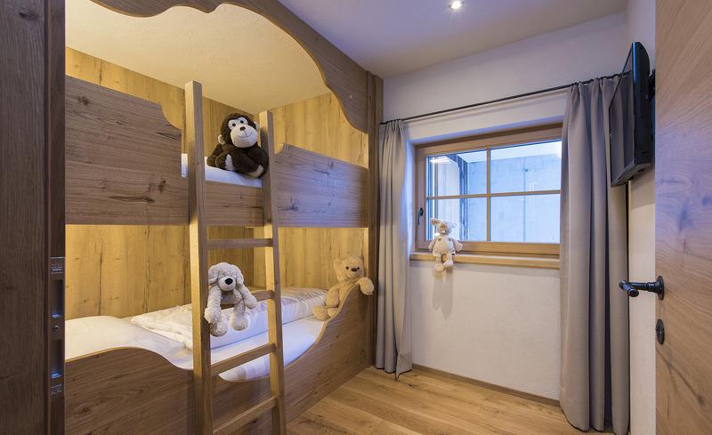 Liebevoll eingerichtete Kinderzimmer bieten den Kindern erholsame Nächte in Ihrem Familienurlaub