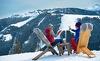 Weingenuss auf der Piste des Skigebietes Alpendorf - Skiurlaub im Hotel Alpendorf